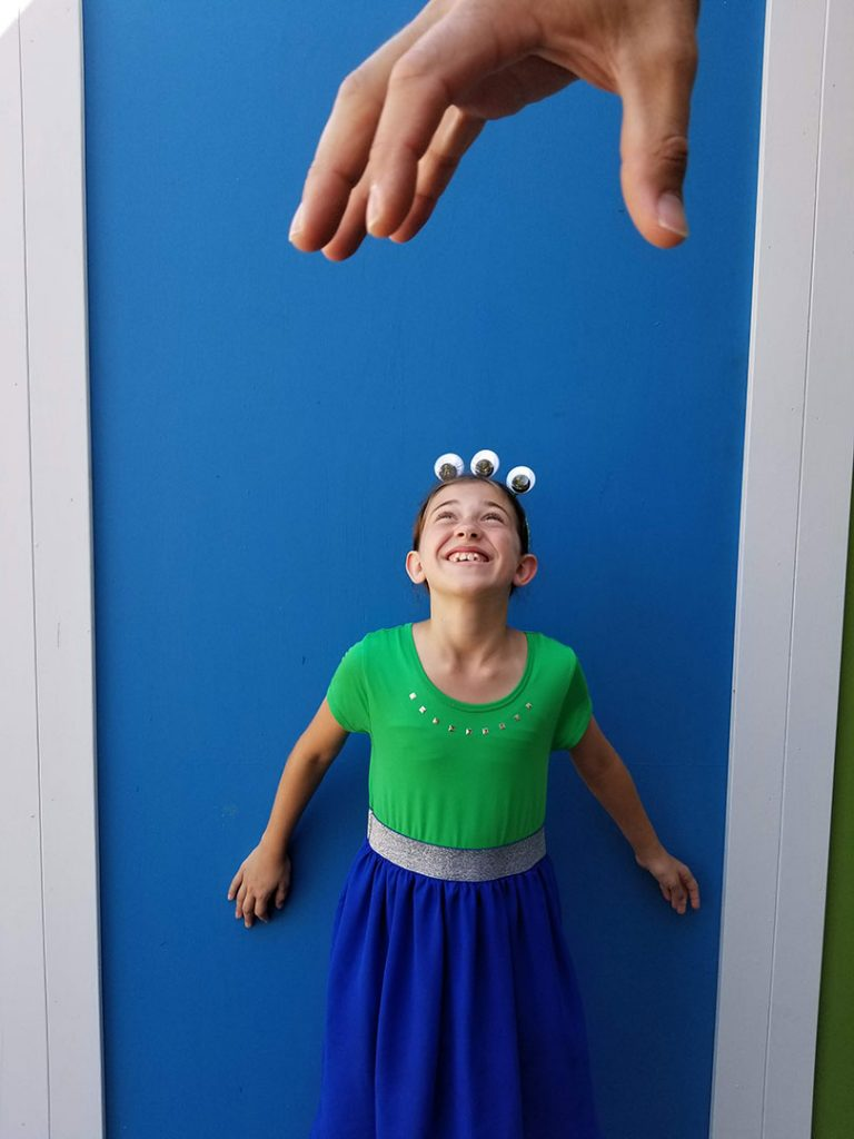 Disney bounding costume that includes eyeballs for alien toys from Toy Story