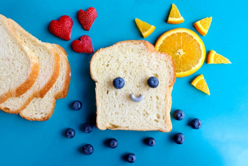 happy bread on blue background