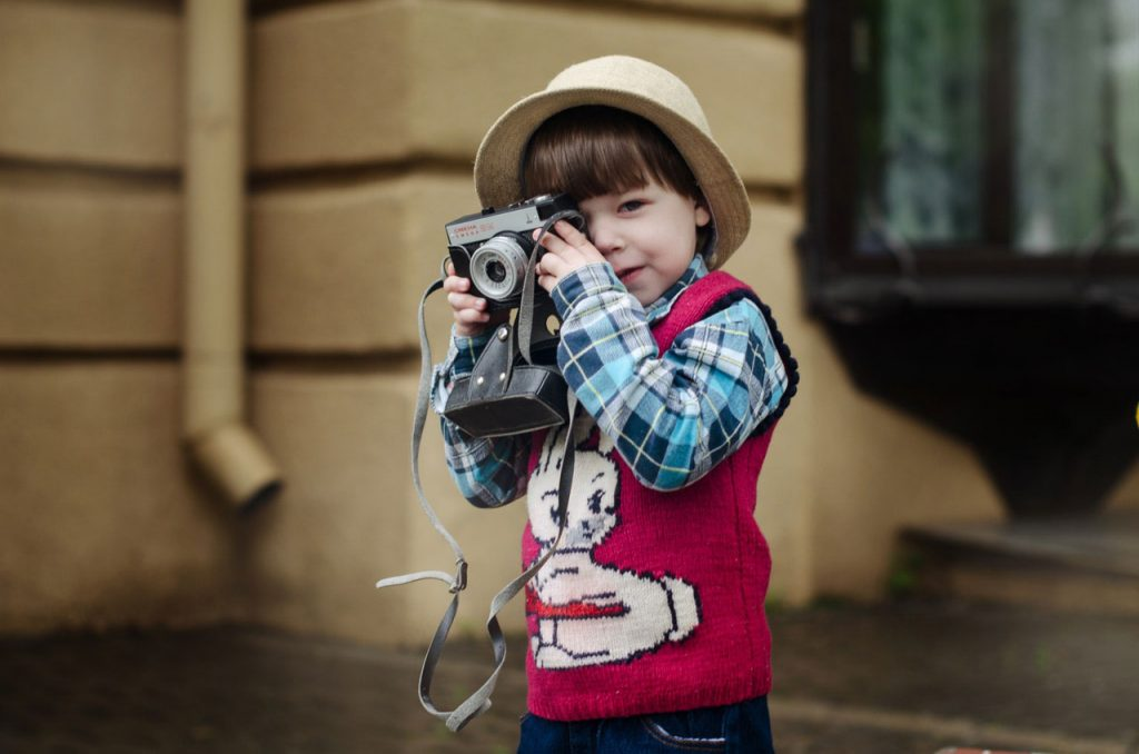 young kid taking photo