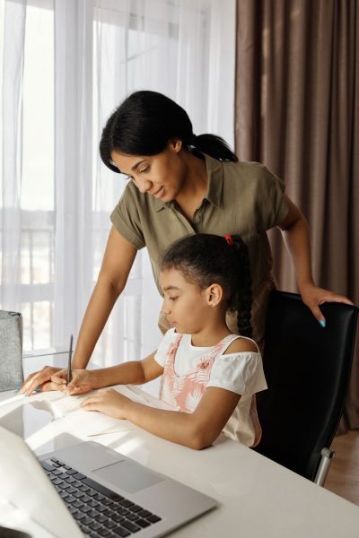 mom and daughter doing home learning with different ways to teach