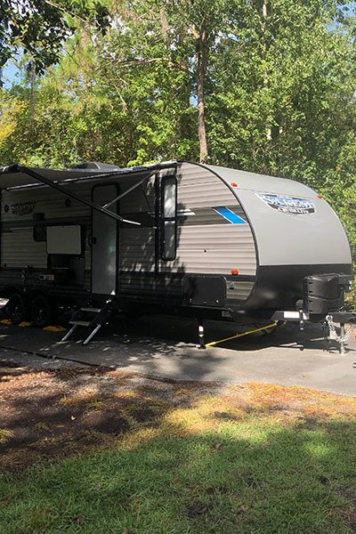 camper and truck at campsite for RV life